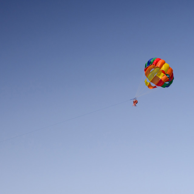 """Colorful parachute on blue sky"" stock image"