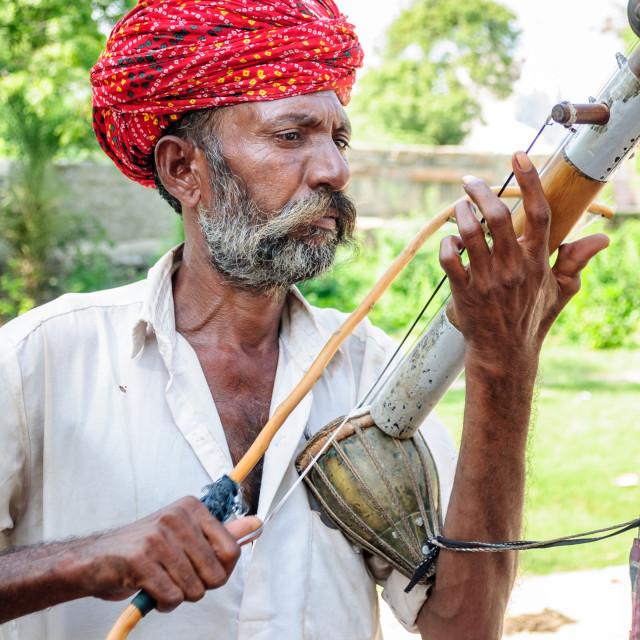 """""""Old folk musician playing Ravanhatha at Mador garden"""" stock image"""