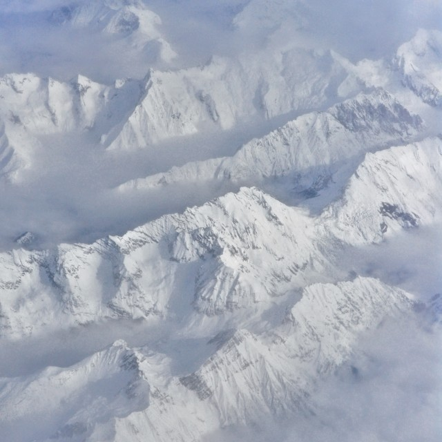 """Alps through the clouds"" stock image"