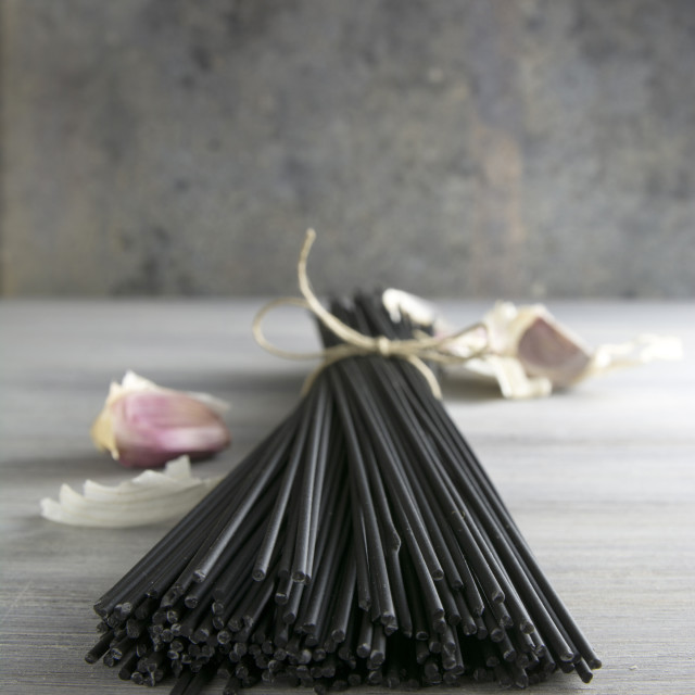 """Raw black spaghetti with squid ink"" stock image"