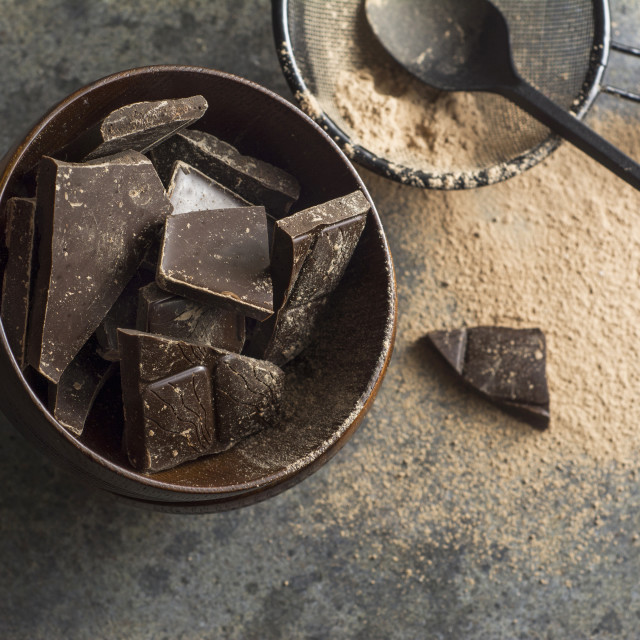 """""""dark chocolate chunks in wooden bowl, on oak table"""" stock image"""