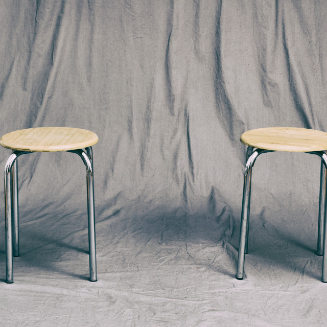 """Two Empty Stools Waiting"" stock image"