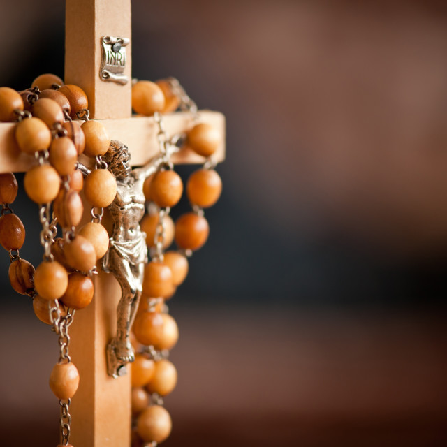 """Jesus figurine and rosary"" stock image"