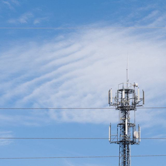 """radio transmitter with antenna on blue sky"" stock image"