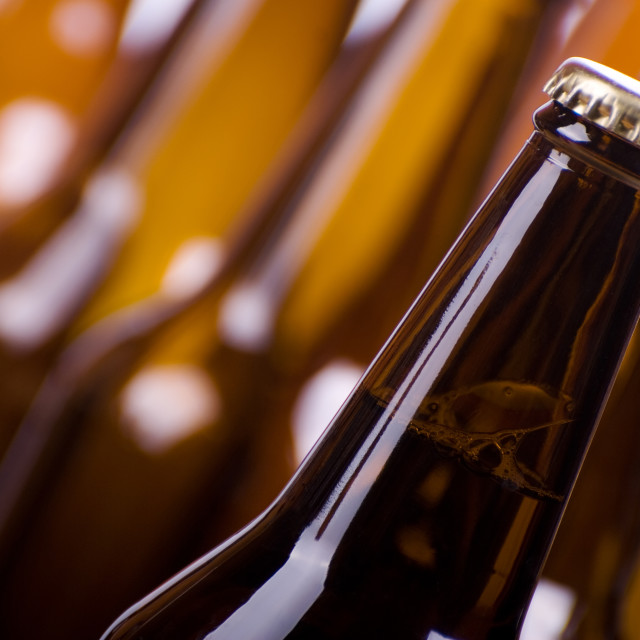 """Full brown glass dark bottle with beer"" stock image"