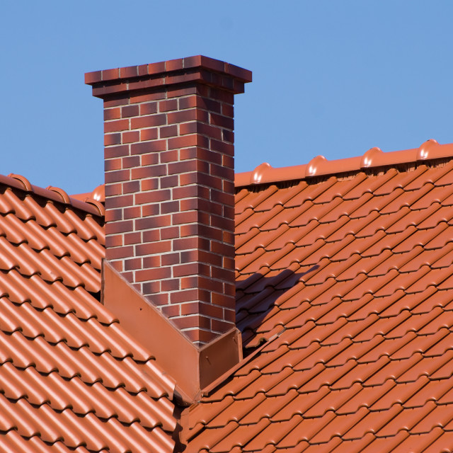 """rows of red tiles sheet roof with chimney"" stock image"