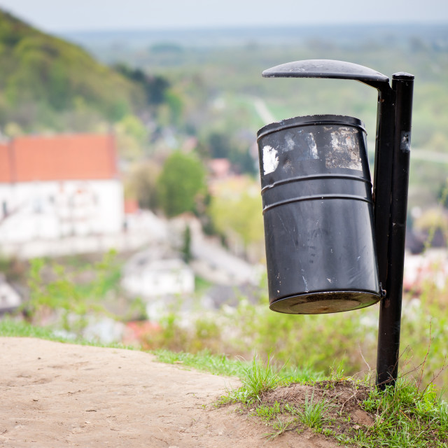"""""""rubbish bin on the hill and blurred dale view"""" stock image"""
