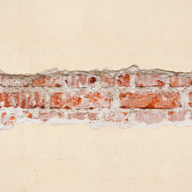 """Red bricks broken wall unveil"" stock image"