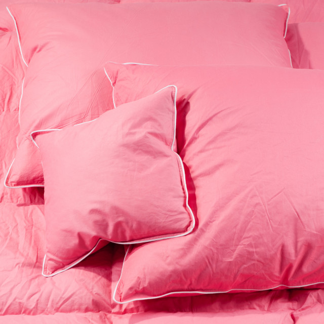 """pink fluffy three pillows on duvet without cover"" stock image"