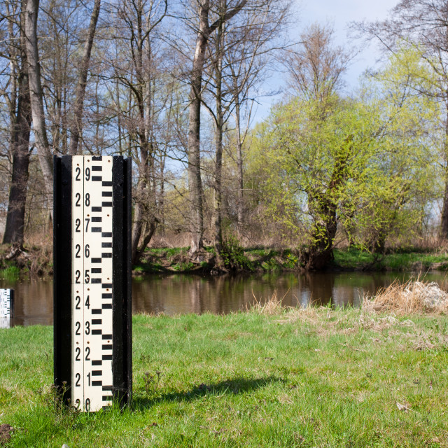"""""""Water flood gauge depth marker and small river"""" stock image"""