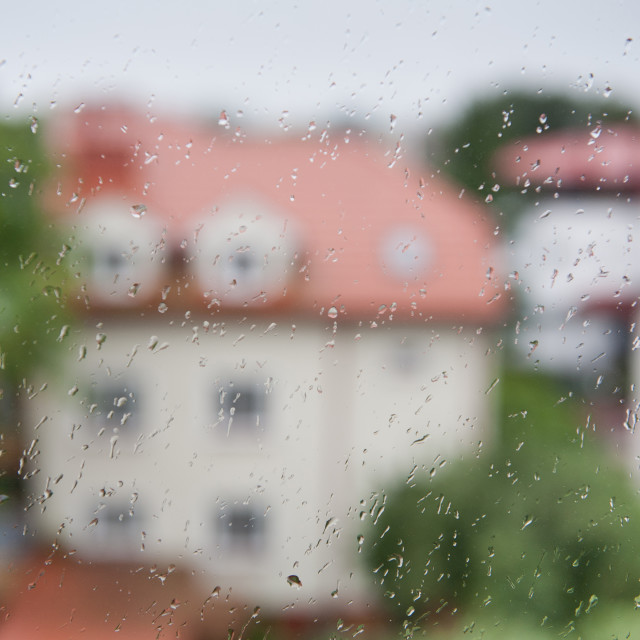 """""""Raindrops flow on window glass home blurred"""" stock image"""