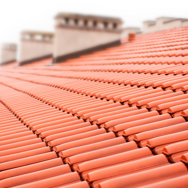 """rows of red tiles roof with chimneys"" stock image"