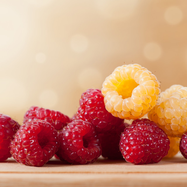 """ripe red and golden raspberry fruits in pile"" stock image"