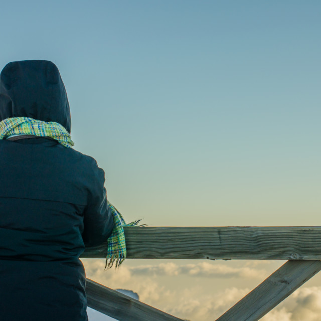 """watching the sea of clouds"" stock image"