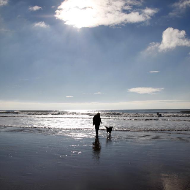 """Sunburst over a winter beach"" stock image"