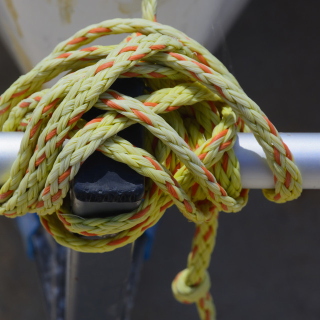 """Knot in yellow and orange nylon"" stock image"