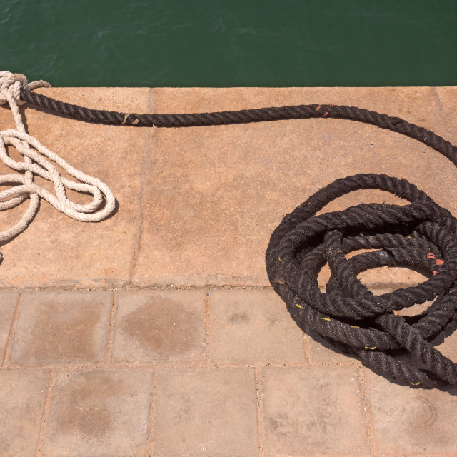 """Mooring rope on jetty"" stock image"