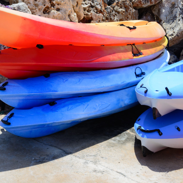 """Colorful kayaks stacked in a marina."" stock image"