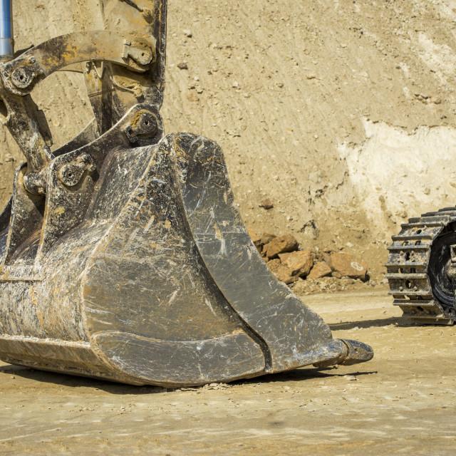 """Excavator bucket and tracks"" stock image"