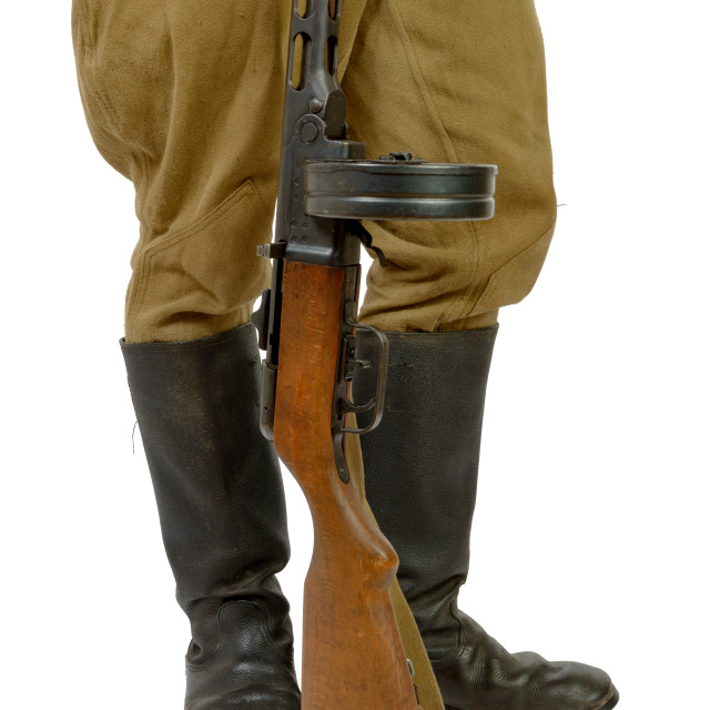 """""""Soviet submachine gun at the foot of a soldier"""" stock image"""