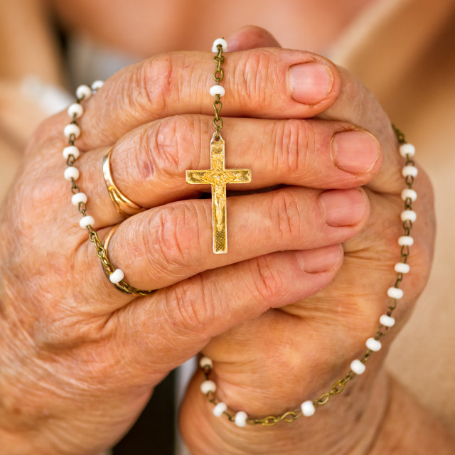 """Praying with a rosary"" stock image"