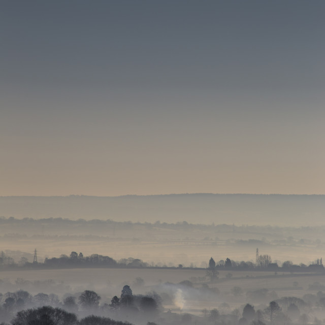 """""""A blue haze view across rolling countryside"""" stock image"""