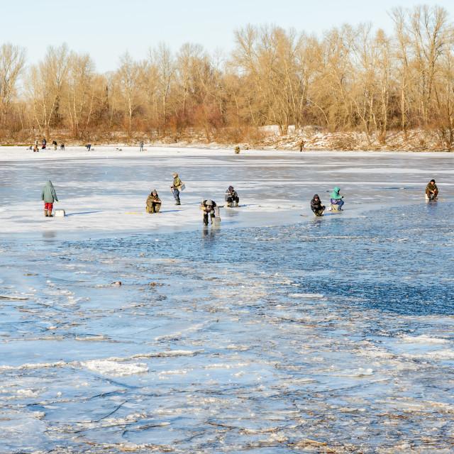 """Fishermen on the Frozen River"" stock image"