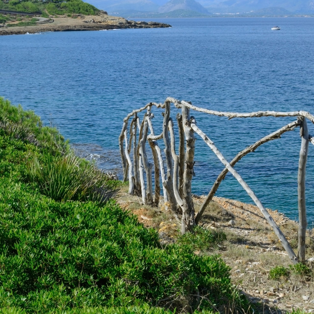 """""""Wood railing by Pollensa bay"""" stock image"""