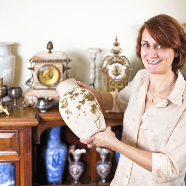 """Woman with antique collection"" stock image"