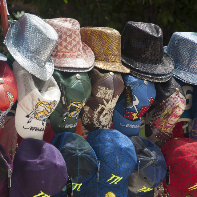 """""""Hats on display in market booth"""" stock image"""