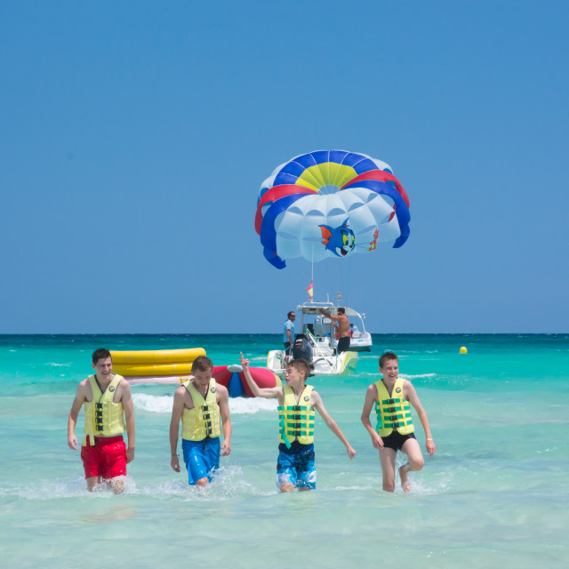 """Four happy parasailers"" stock image"