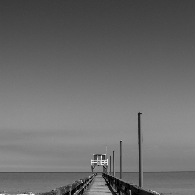 """A Pier in Black & White"" stock image"