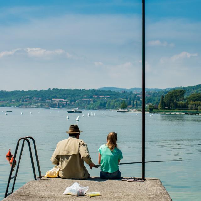 """Man and girl fishing on Garda lake"" stock image"