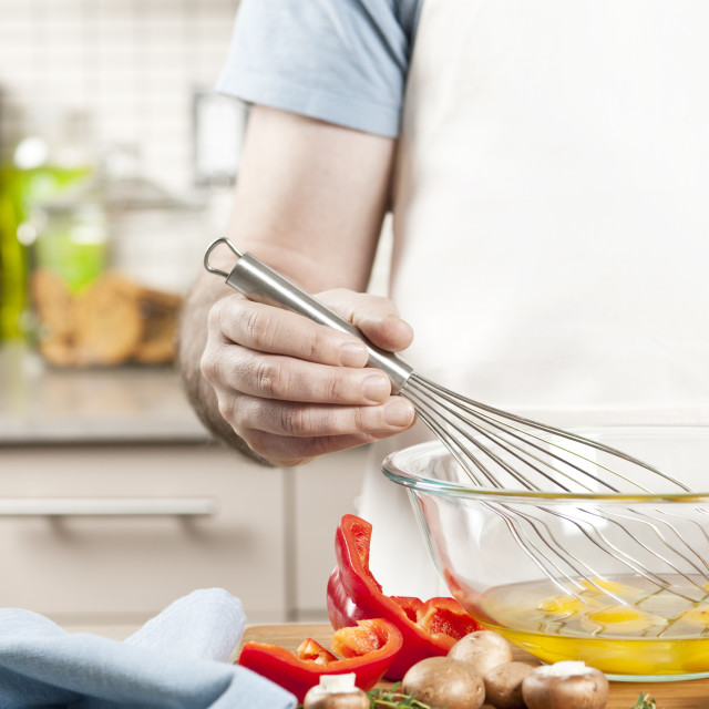 """Whisking eggs in bowl"" stock image"