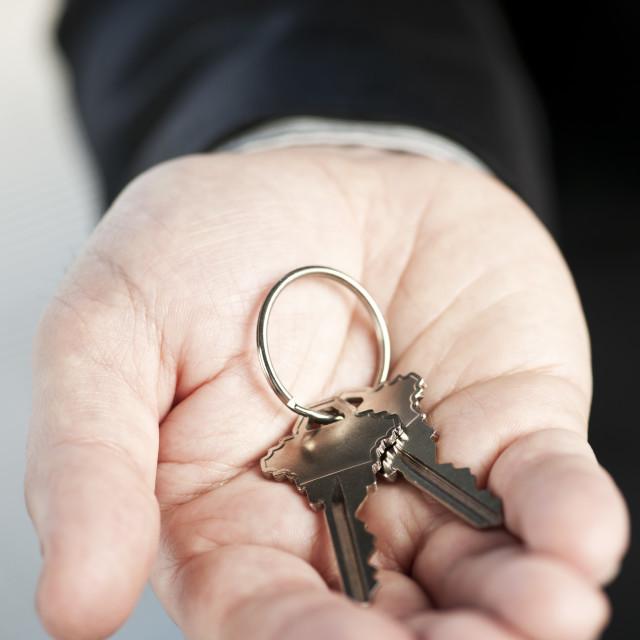 """Hand offering new keys"" stock image"