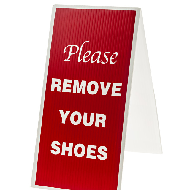"""Remove your shoes sign"" stock image"