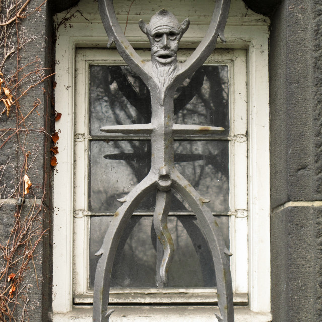 """""""the devil as a window grate"""" stock image"""