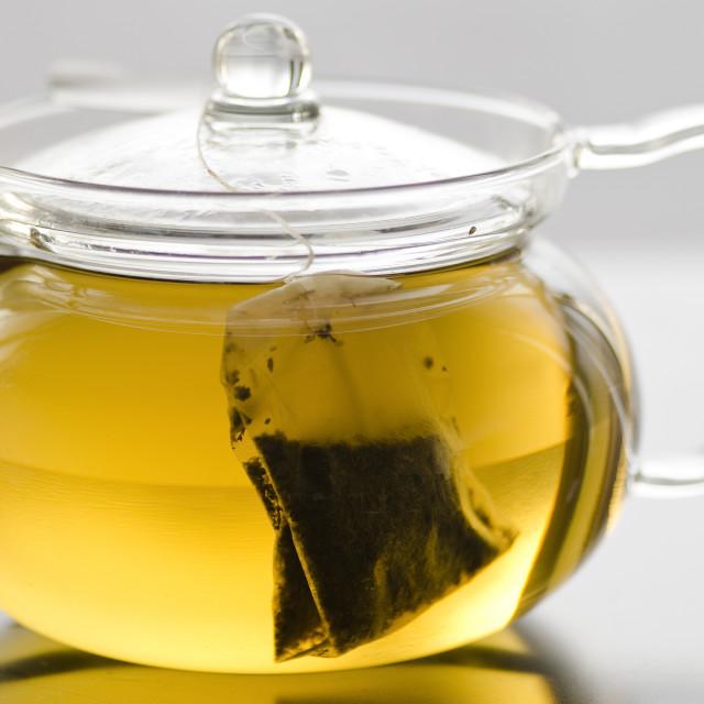 """""""Glass tea pot with tea bag"""" stock image"""