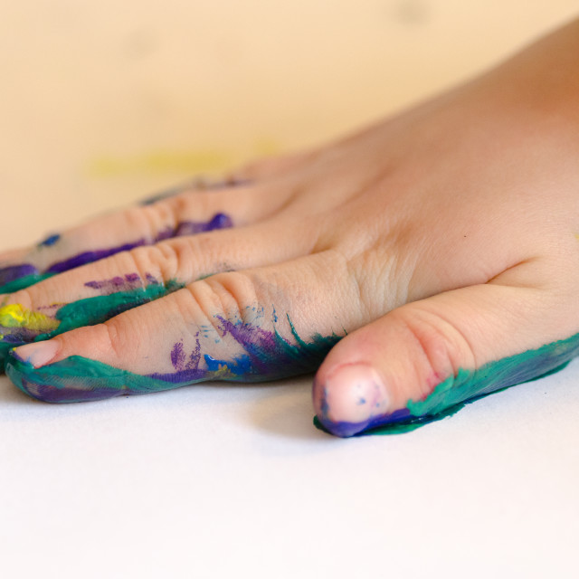 """Child painting with hands"" stock image"