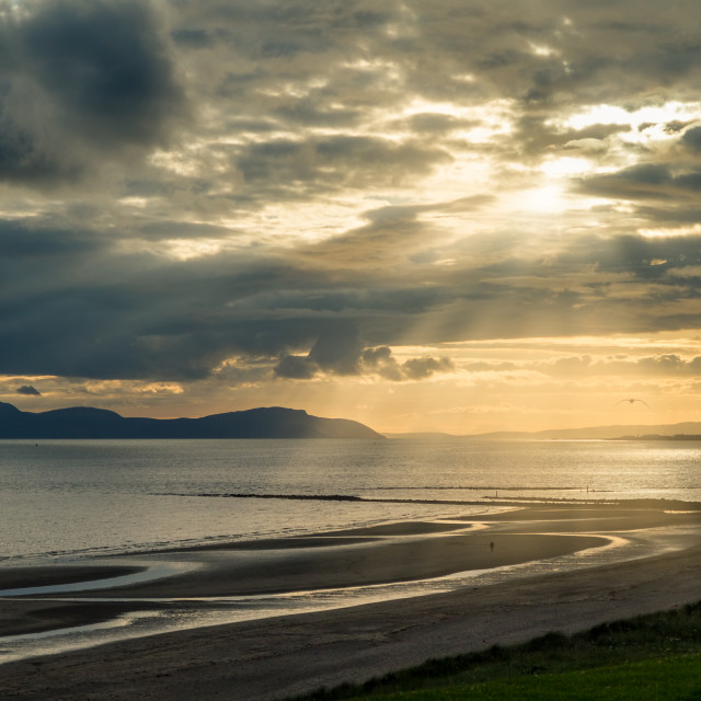 """Sun rays over Irvine Beach"" stock image"