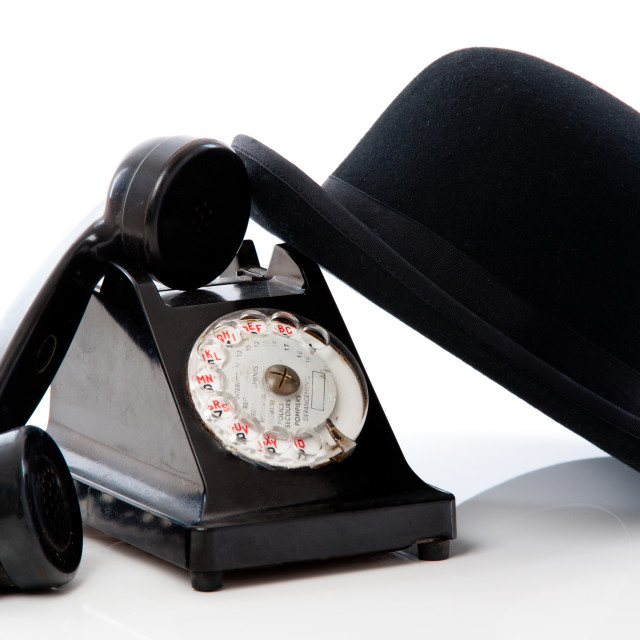 """Old telephone and hat"" stock image"