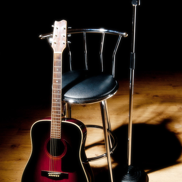 """Guitar Microphone and stool"" stock image"