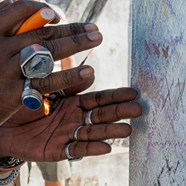 """""""Lighting Incense at the Tomb of Marie Laveau in New Orleans"""" stock image"""