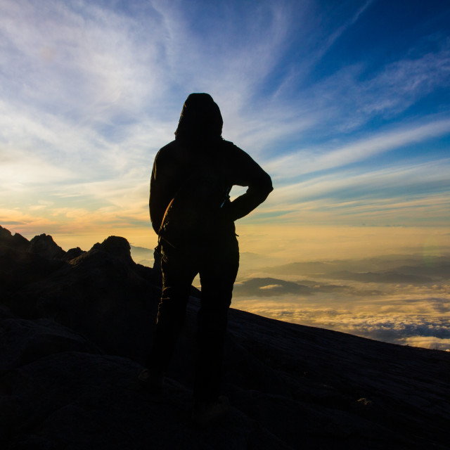 """Woman hiker on top of mountain for sunrise or sunset"" stock image"