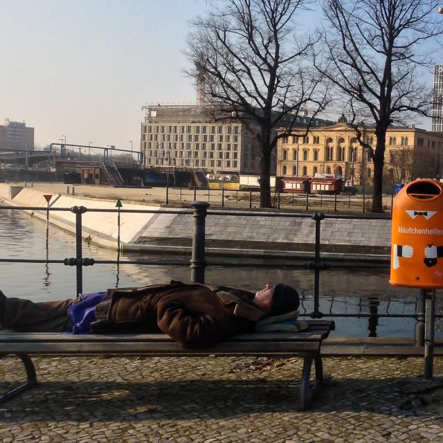 """Man asleep on bench"" stock image"