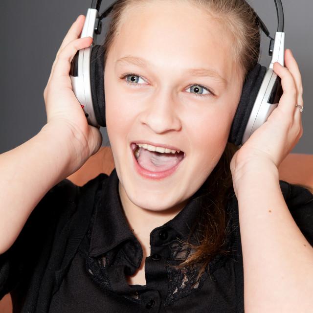 """happy girl listening to music"" stock image"