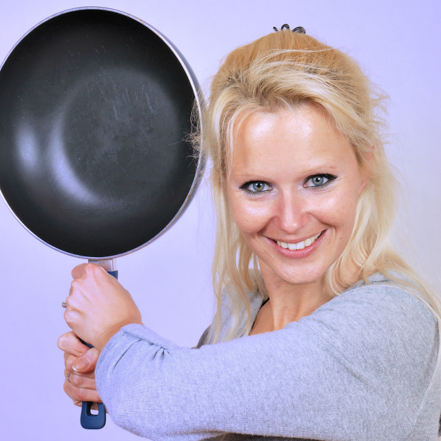 """Woman beating with a frying"" stock image"