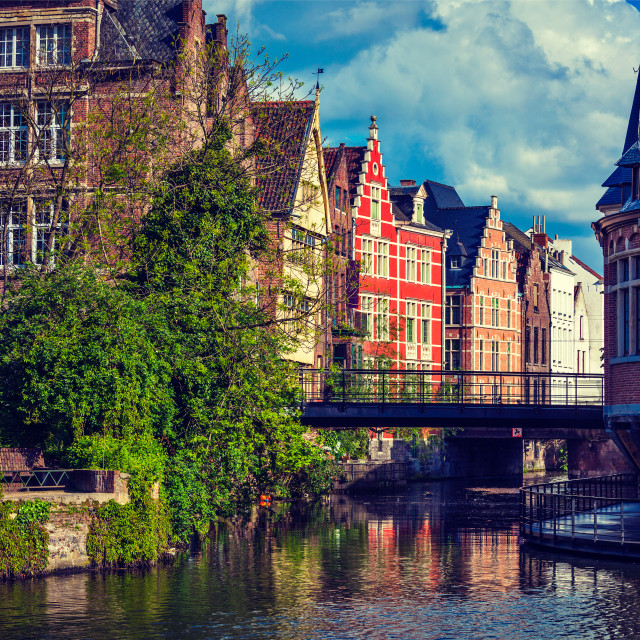 """""""Travel Belgium medieval european city town background with canal. Ghent, Belgium. Retro vintage hipster style cross processed."""" stock image"""