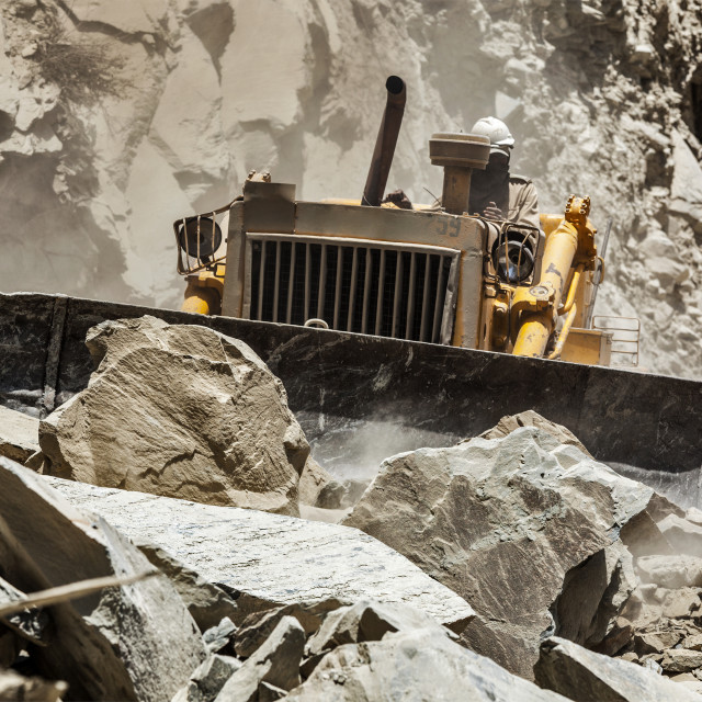 """Bulldozer doing road construction in Himalayas"" stock image"