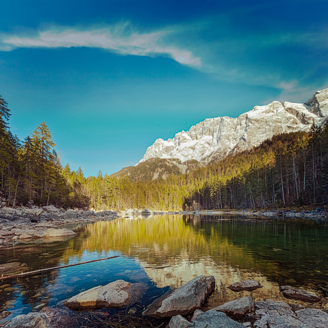 """Vintage retro hipster style travel image of Frillensee (small lake near Eibsee) and Zugspitze - the highest mountain in Germany"" stock image"